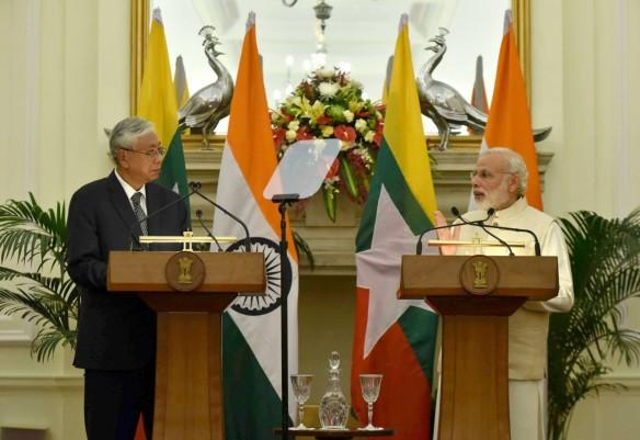 Prime Minister Narendra Modi with Myanmar  President Htin Kyaw addresses a joint media briefing at Hyderabad House in New Delhi on Aug. 29, 2016.