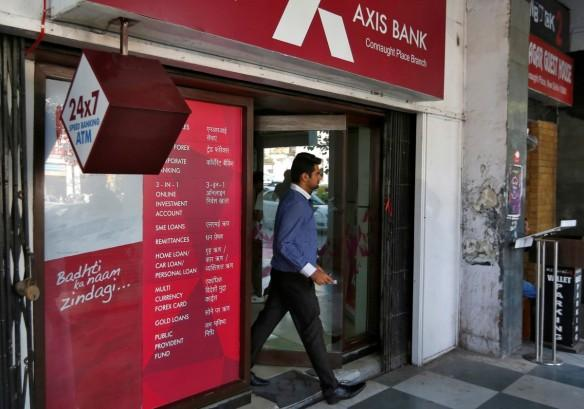 axis bank q2 share price essar group loans npas income private sector lender atm cyber security attack debit cards issues npas bad loans forex branches atms