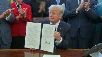 Trump signs executive order for lean government