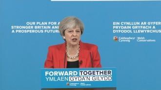 Theresa May attacks Jeremy Corbyn over social care