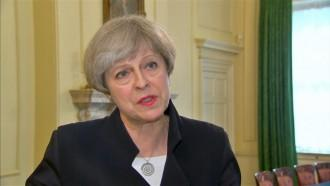 Theresa May: UK security threat level lowered after significant police activity
