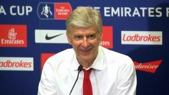 Wenger hints he hopes to stay at Arsenal after FA Cup win