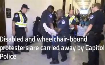 Police drag away protesters in wheelchairs from Mitch McConnells office