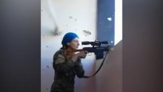 Female Kurdish fighter laughs after nearly being shot by Isis sniper