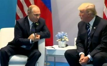 Donald Trump accused of secret meeting with Vladimir Putin amid Russian interference investigations