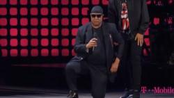 Stevie Wonder takes a knee for America