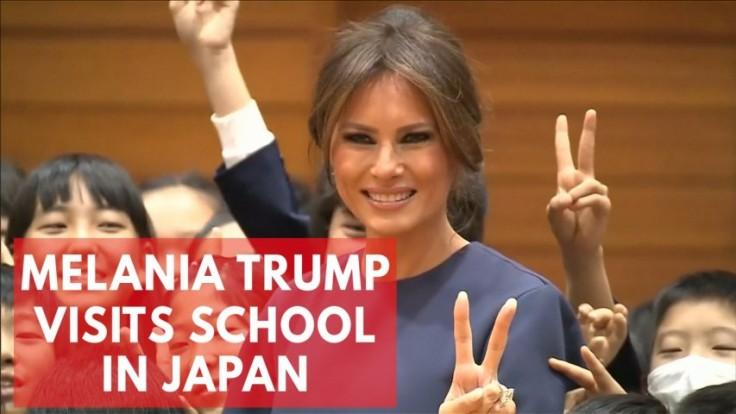 Melania Trump visits school in Tokyo, writes peace in calligraphy