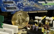 A copy of bitcoin standing on PC motherboard is seen in this illustration picture, October 26, 2017.