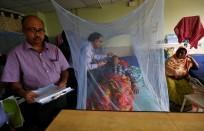 Kolkata, IndiaA doctor examines a dengue fever patient at a government hospital in Kolkata, India, October 31, 2017. REUTERS/Rupak De Chowdhuri