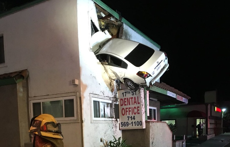 Car flies through air and gets stuck into a two storey for What goes into building a house