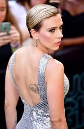 Actress Scarlett Johansson was spotted here with a large piece of body art on her back. The 32-year-old stepped out here on Monday in a black top. Her new tattoo was visible clearly across her upper back, reports aceshowbiz.com.
