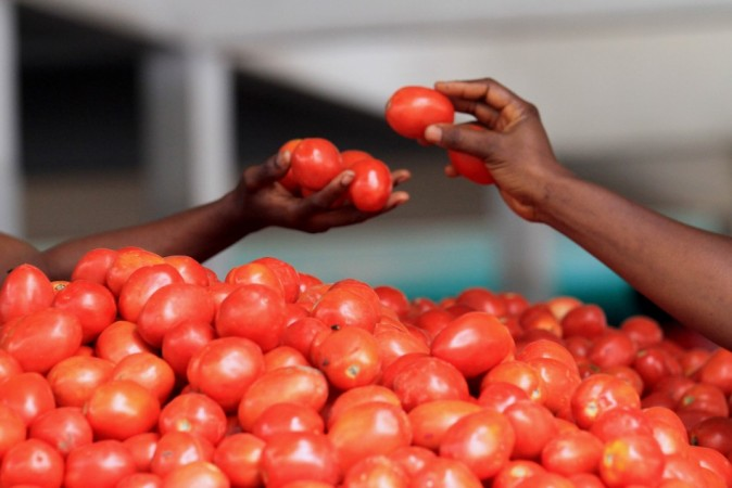 A woman buys tomatoes at Gouro market in Abidjan