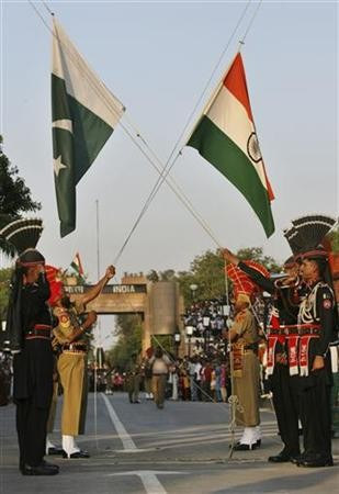 Pakistani Rangers and BSF lower their respective country flags during daily parade in Pakistan India joint check post in Wagah border
