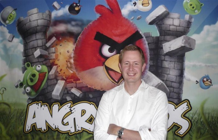 Rovio Chief Executive Mikael Hed stands in front of an Angry Birds poster at his company's offices in Helsinki