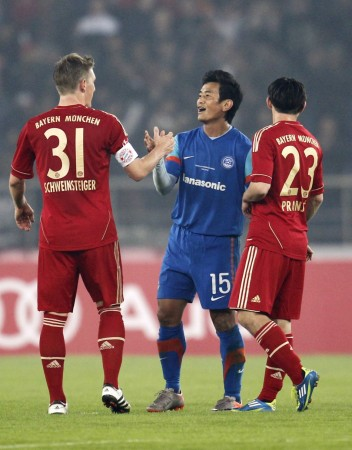 Baichung Bhutia and Bastian Schweinsteiger