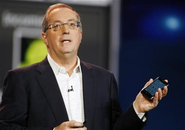 Paul Otellini, CEO of Intel Corp. (Nasdaq: INTC) holds an Intel smartphone.