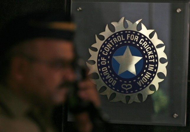 A policeman walks past a logo of the Board of Control for Cricket in India (BCCI) during a governing council meeting of the Indian Premier League (IPL) at BCCI headquarters in Mumbai April 26, 2010.