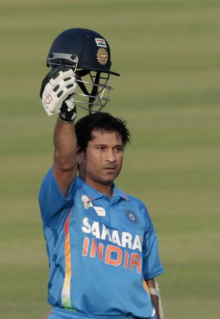 India's Sachin Tendulkar celebrates after he scored his 100th international century during their Asia Cup one- day international (ODI) cricket match against Bangladesh in Dhaka March 16, 2012.