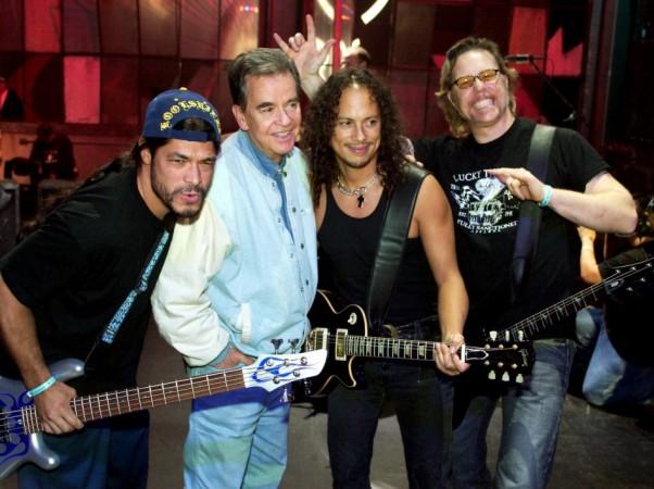 Metallica bassist Robert Trujillo, Dick Clark, Metallica guitarist Kirk Hammett and singer/guitarist James Hetfield, pose while the rock band rehearses for the 31st annual American Music Awards at the Shrine Auditorium in Los Angeles, California, November