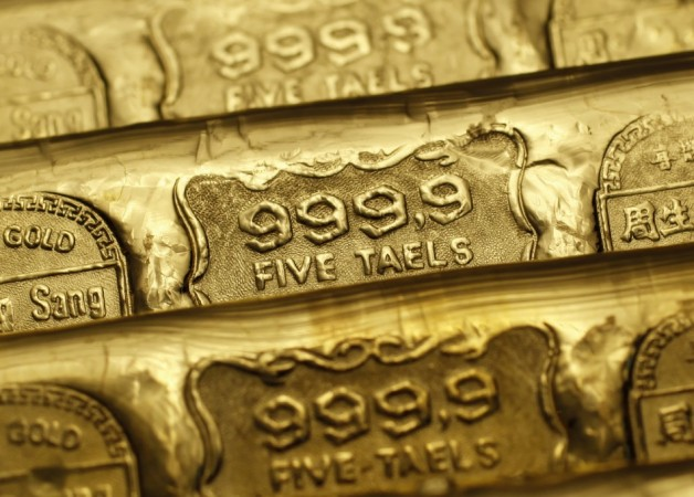 Prices of the safe haven yellow precious gold metal jumped 0.2 per cent to $1,751.80 an ounce after finance ministers in the heavily fiscal-affected eurozone and the International Monetary Fund (IMF) agreed to reduced Greece's long-term debt.