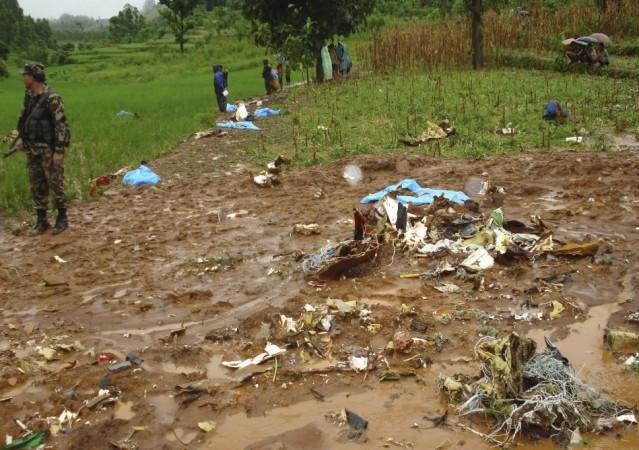 Aircraft debris is seen scattered at the Agni Air crash site in Shikharapur of Makwanpur near Kathamandu