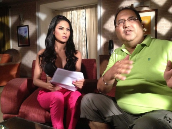 Veena Malik with director Navin Batra. Image:Scribes INC