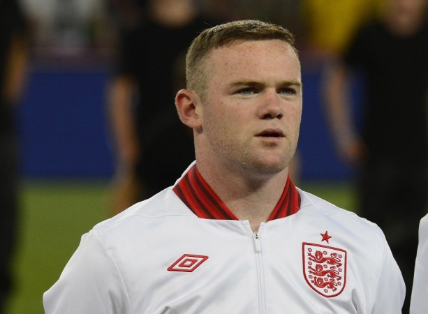 Wayne Rooney warned about using Twitter account to promote Nike