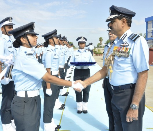 The Chief of Air Staff, Air Chief Marshal N.A.K. Browne congratulates the newly commissioned Flying Officers