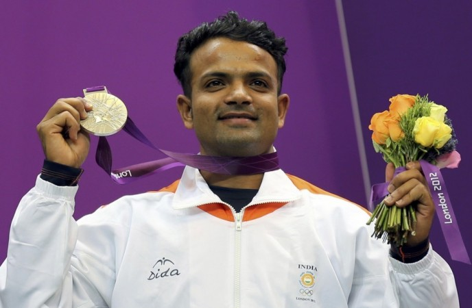 India's silver medal winner Vijay Kumar poses with his silver medal won in the men's 25m rapid fire pistol shooting event at the London 2012 Olympic Games