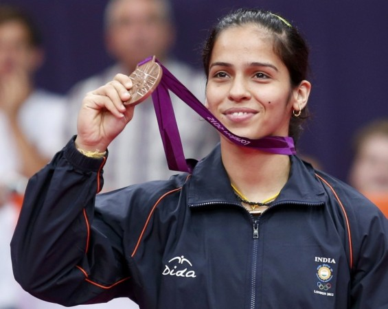 India's Saina Nehwal holds up her bronze medal at the women's singles badminton victory ceremony at the London 2012 Olympic Games at the Wembley Arena.
