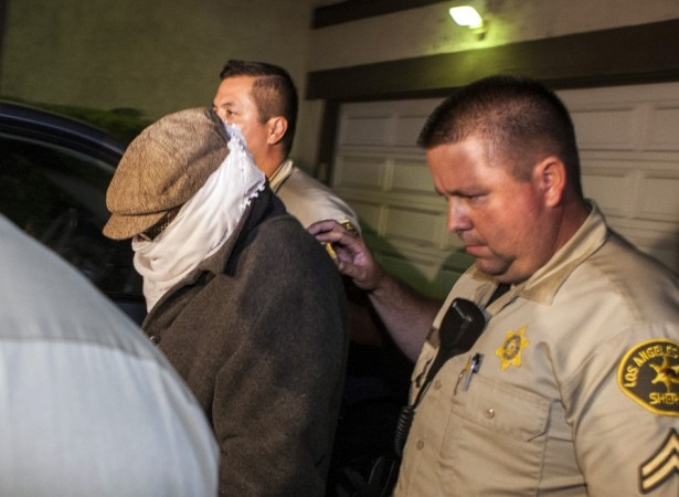 Nakoula Basseley Nakoula is escorted out of his home by Los Angeles County Sheriff's officers in Cerritos, California