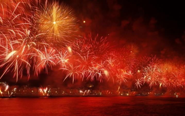 Fireworks explode above Copacabana beach in Rio de Janeiro