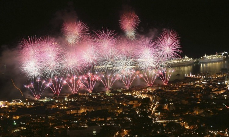 Fireworks explode over the Funchal city bay during year end celebrations in Madeira Island