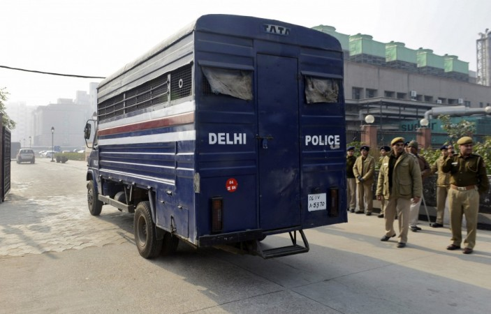 A police van carrying five men accused of the gang rape and murder of an Indian student arrives at a court in New Delhi January 7, 2013.