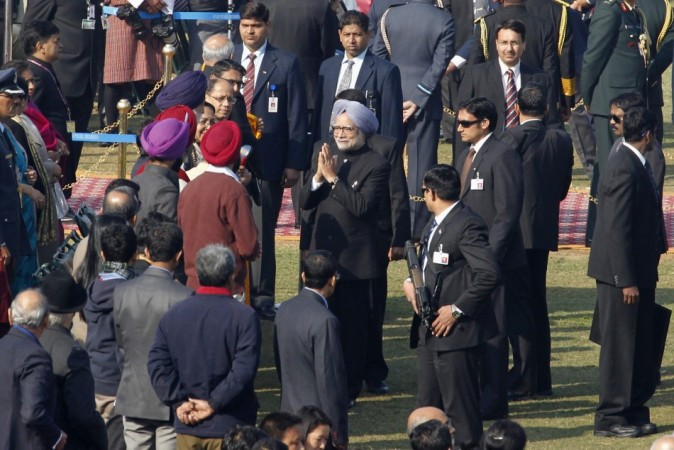 Indian Prime Minister Manmohan Singh is greeted by officials upon his arrival before the start of the Republic Day parade in New Delhi. (Reuters)