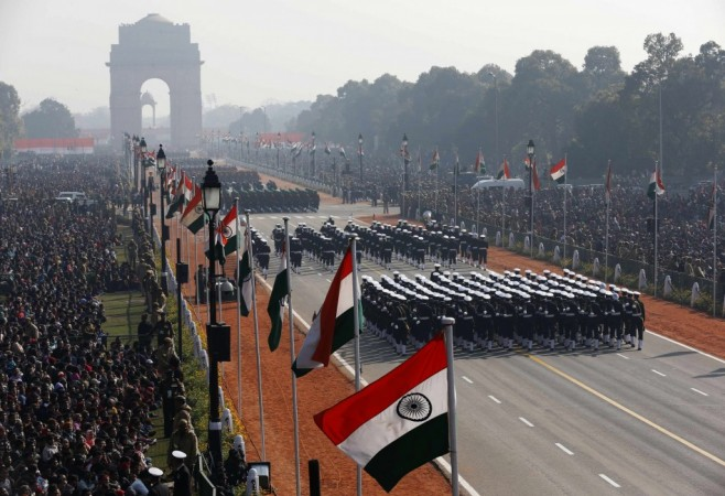 People watch Indian soldiers march during the Republic Day parade in New Delhi (Reuters)