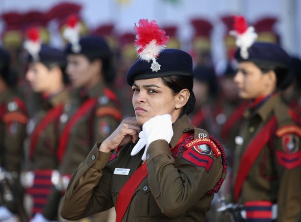 Policewoman adjusts her neck scarf during the Republic Day parade in Chandigarh (Reuters)
