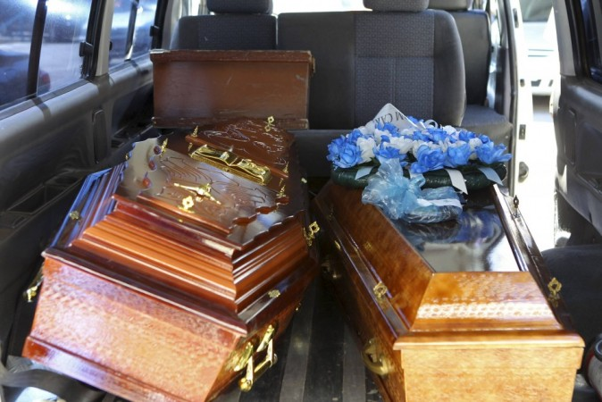 Coffins containing the bodies of victims from fire at Boate Kiss nightclub are seen inside a funeral home vehicle in the southern city of Santa Maria
