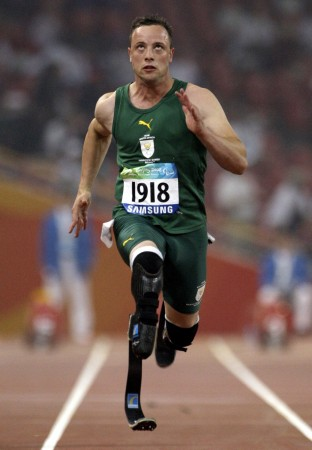 File photo of South Africa's Oscar Pistorius running. He is reportedly dating a teen student ahead of his trial on march 3.