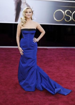 Actress Reese Witherspoon, wearing a black and royal blue Louis Vuitton gown, arrives at the 85th Academy Awards in Hollywood (Reuters)