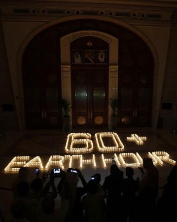 Saudis light candles to mark Earth Hour at the Ritz Carlton in Riyadh