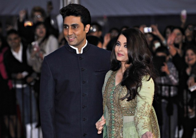 Bollywood actor Abhishek Bachchan arrives with his wife actress Aishwarya Rai for the inaugural Times of India Film Awards in Vancouver
