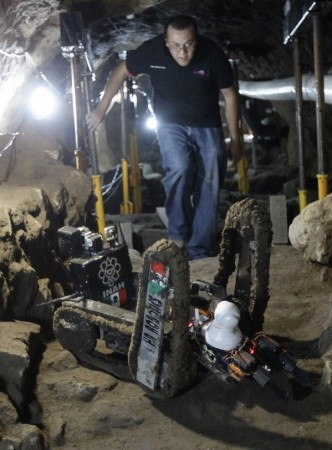 A robot used to explore ruins is seen on the entrance of a tunnel in the archaeological area of the Quetzalcoatl Temple near the Pyramid of the Sun