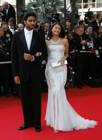 Bollywood star Abhishek Bachchan and his wife, Bollywood actress Aishwarya Rai arrive for an evening gala screening of Chinese director Wong Kar Wai's in-competition film