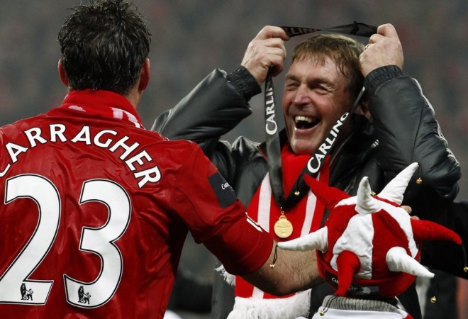 Kenny Dalglish (right) and Jamie Carragher (left) celebrate winning the League Cup