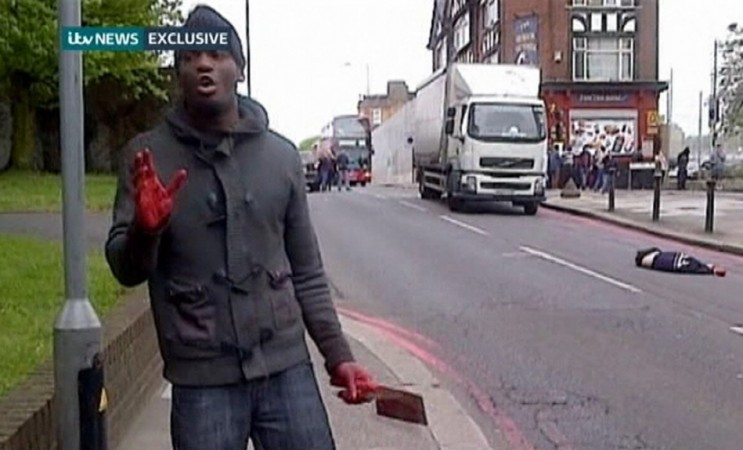 A man with bloodied hands and knives appears in a still image from amateur video that shows the immediate aftermath of an attack in which a man was killed in southeast London (Reuters)