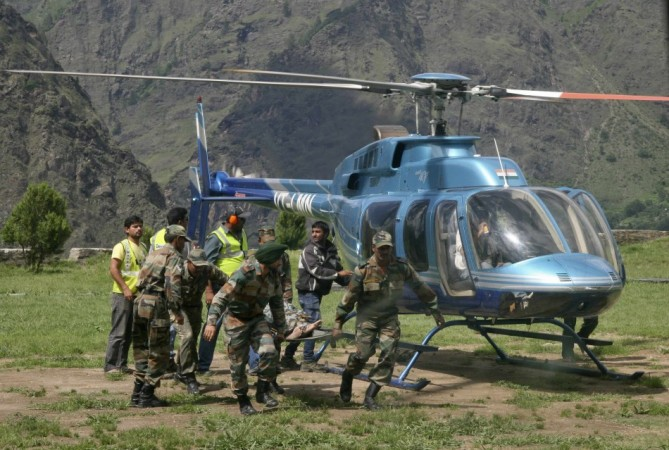 Soldiers carry the body of a flood victim after heavy rains in the Himalayan state of Uttarakhand(Reuters)