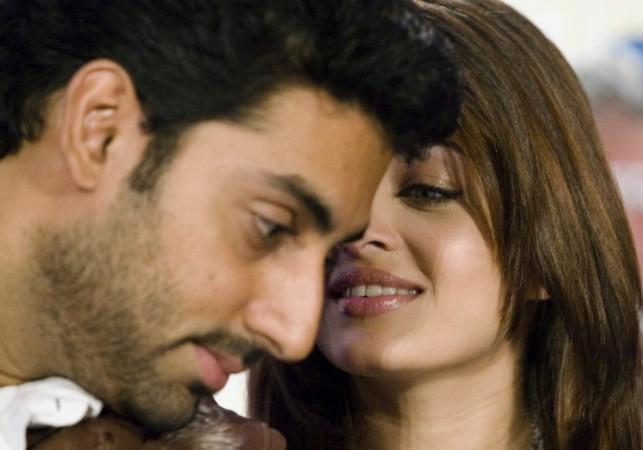 Bollywood actors Abhishek Bachchan and Aishwarya Rai Bachchan (R)