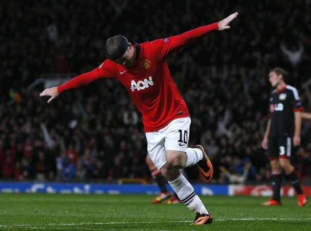 Wayne Rooney celebrates after scoring against Bayer Leverkusen in the Champions League