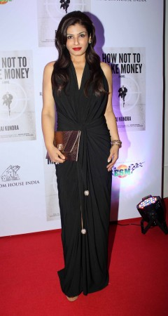 Raveena Tandon falunts a floor length gown with blood red lips  (photo Varinder Chawla)